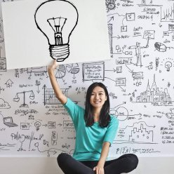 woman-draw-a-light-bulb-in-white-board-3758105